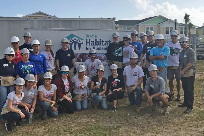 Members of the Ponte Vedra Beach Rotary and Beaches Rotaract clubs assist Habitat for Humanity.