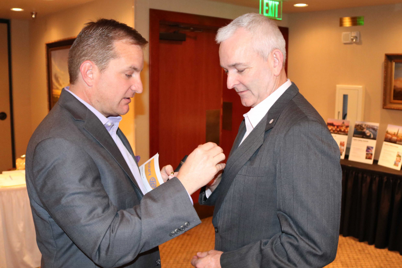 President Billy Wagner presents Pat Shea with his membership pin