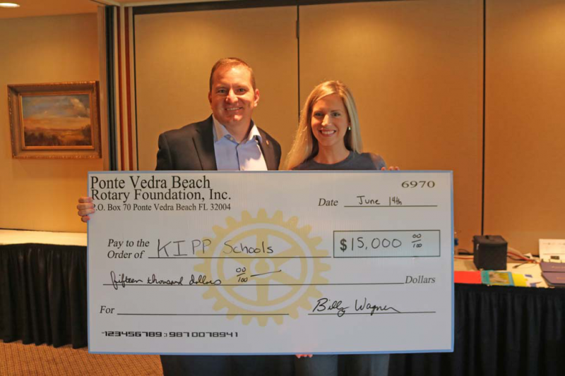 Billy Wagner presents a donation to KIPP Schools Development Director Stephanie Salustro